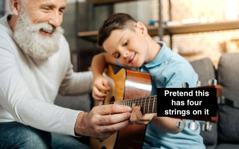 Kid Learning Guitar with his Instructor
